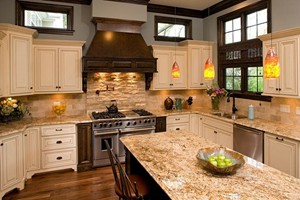 KITCHEN BACKSPLASH - ANATOLIA IVORY TUMBLED 3X6 AND IVORY SPLIT FACE LEDGESTONE